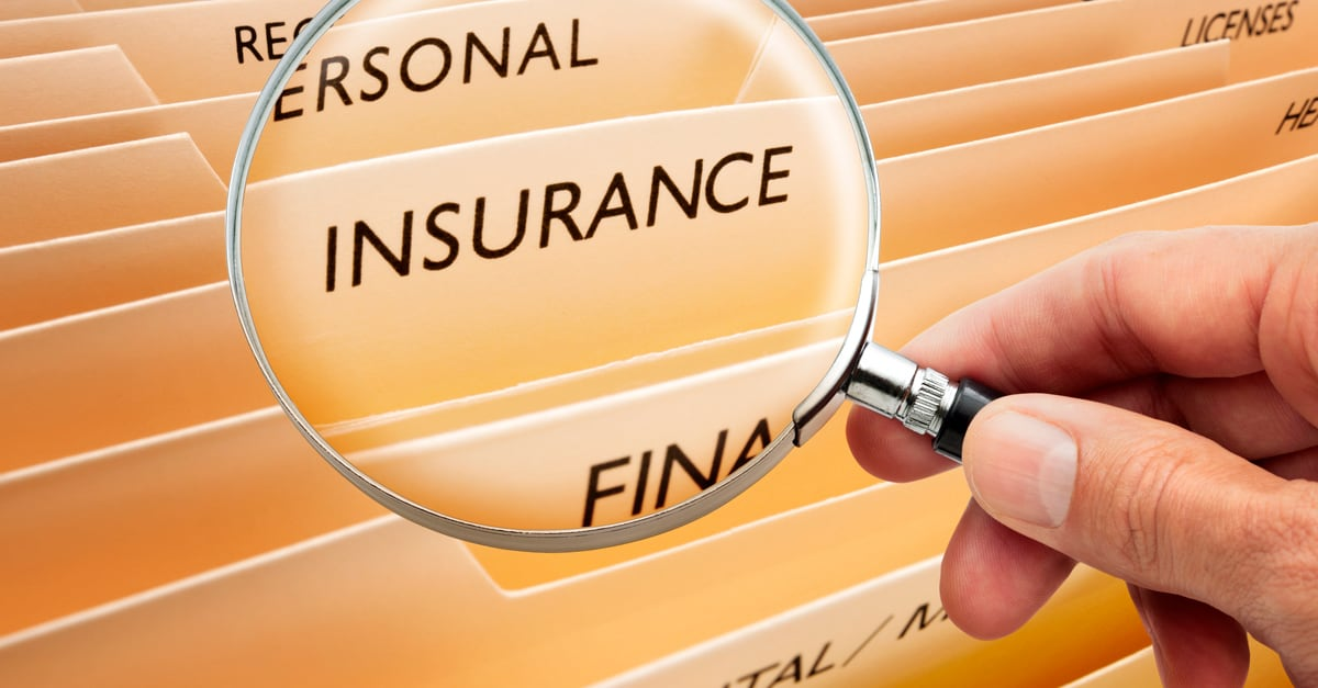 Magnifying glass over insurance folder, photo credit ID 18373059 | Cammeraydave | Dreamstime.com